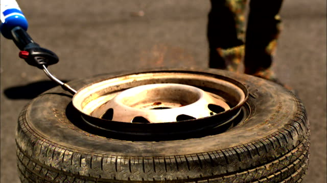 a flame ignites over a tire. - flammable stock videos & royalty-free footage