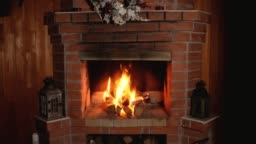 flame of fire burns in brick home Christmas fireplace.