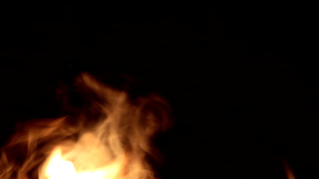 Flame on a dark background. Flame in the fireplace.