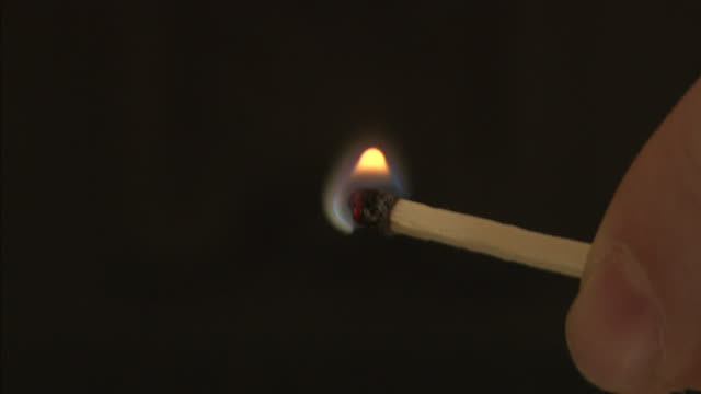 stockvideo's en b-roll-footage met a flame results from the strike of a matchstick against a matchbox. - lucifer