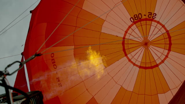 ms flame rising and inflating hot air balloon - hot air balloon stock videos & royalty-free footage