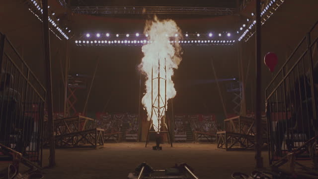 a flame shoots up in the middle of a circus ring. - stunt stock videos & royalty-free footage