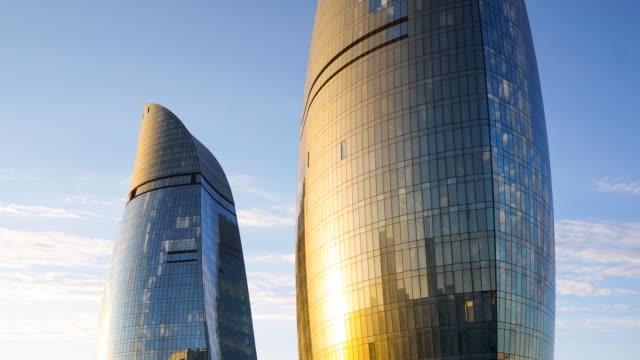 tl flame towers (business centers), sunset view. close-up / azerbaijan, baku - azerbaigian video stock e b–roll