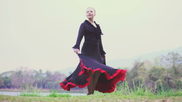 flamenco dancer performing in the garden - flamenco dancing stock videos and b-roll footage