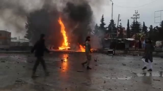 flames and smoke rise after an attack with bomb laden vehicle in the northern syrian town of ras al-ayn, which was liberated from pkk, listed as a... - クルド人点の映像素材/bロール