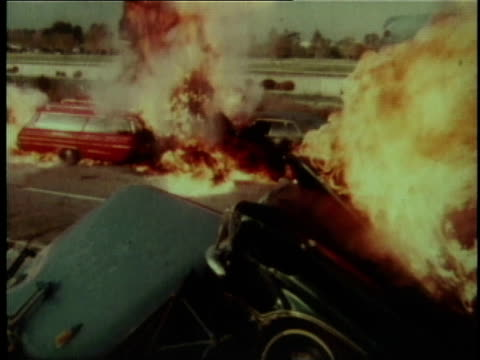1978 ws flames bellow from the wreckage of multiple automobiles - 1978 stock-videos und b-roll-filmmaterial