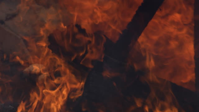 flames burn behind and around charred and fallen beams of a house being destroyed by fire - myrtle creek stock videos & royalty-free footage