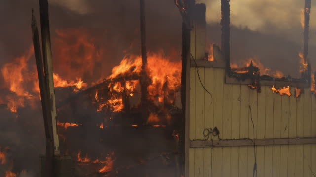 flames consume charred rubble inside a house destroyed by fire - myrtle creek stock videos & royalty-free footage