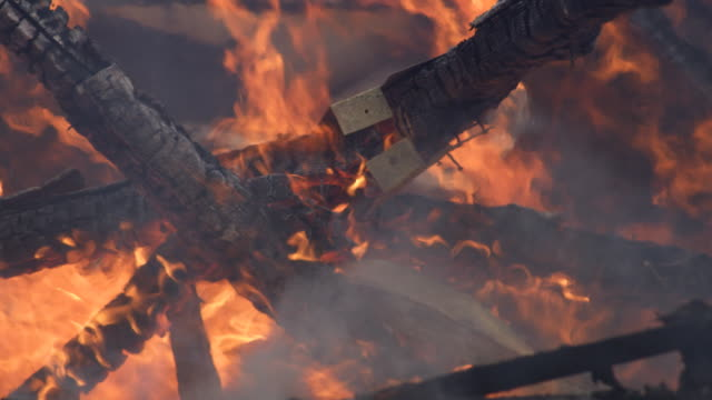 flames consume charred timbers beneath the brackets and nails that fastened them - myrtle creek stock videos & royalty-free footage