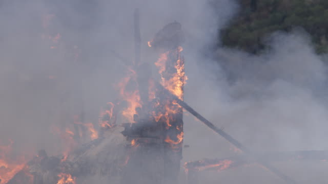 flames consume the charred remnants of posts as fire reduces a house to rubble - myrtle creek stock videos & royalty-free footage