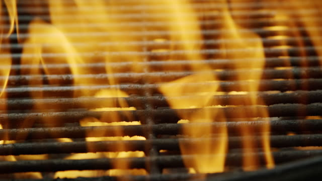flames dance in an outdoor barbecue grill - flame stock videos & royalty-free footage