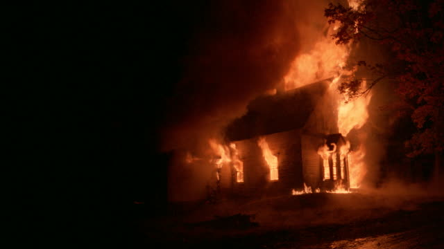 flames engulf a house at night. - inferno stock videos & royalty-free footage