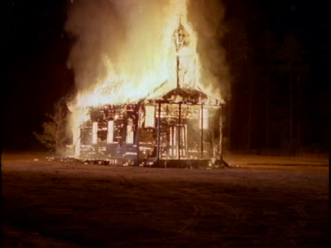flames engulf a small country church. - kirche stock-videos und b-roll-filmmaterial