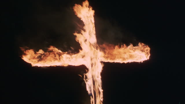 flames engulf a wooden cross. - ku klux klan stock videos and b-roll footage