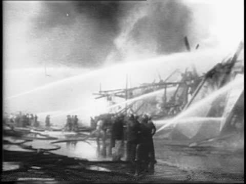 flames erupt at shipyard / firefighting boats battling flames / montage of firefighters putting out flames with hoses - henry j. kaiser stock videos and b-roll footage