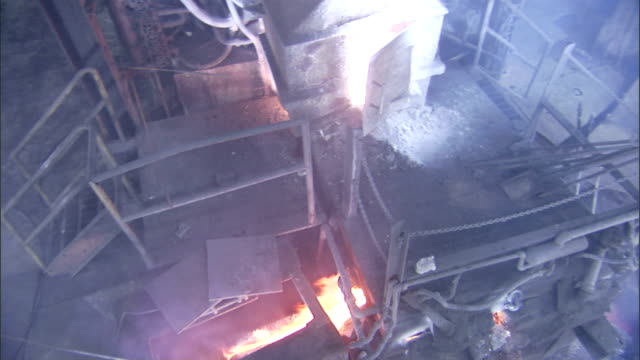 flames escape from a furnace in a steel mill. - power equipment stock videos & royalty-free footage