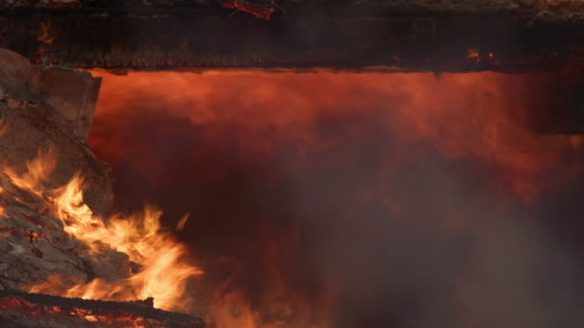 flames flare and roll beneath the charred beams of a burning structure - myrtle creek stock videos & royalty-free footage