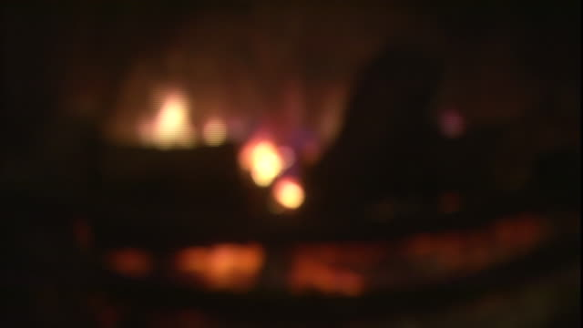 flames flicker on a log as it burns in a fireplace. - log stock videos & royalty-free footage