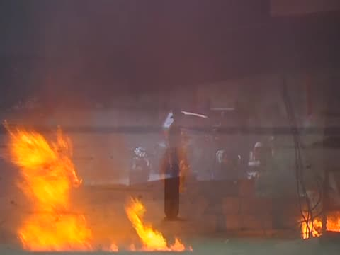 flames from small fire following violent clashes between antigovernment protesters and armed government forces thailand 15 may 2010 - violence stock videos & royalty-free footage