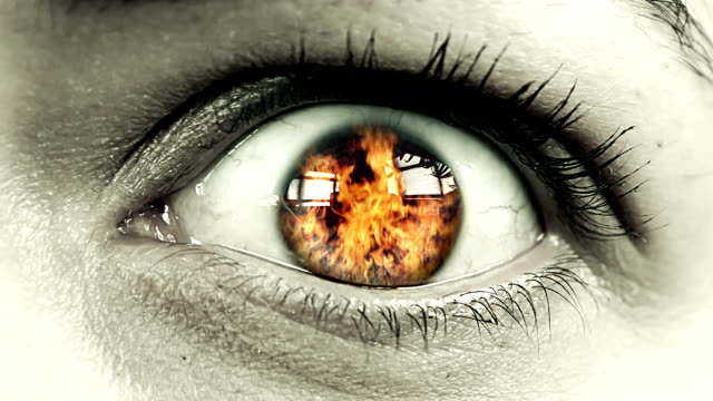 flames in close up female eye - negative emotion stock videos & royalty-free footage