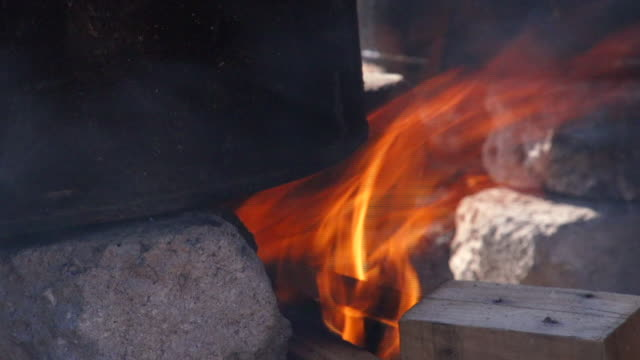 flames licking side of cast iron pot cosmo city south africa cosmo city is a new suburb of johannesburg only being developed in 2005 - cast iron stock videos and b-roll footage