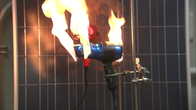 flames melt the plastic of a hair dryer. - flammable stock videos & royalty-free footage