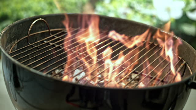 slo mo r/f flames of the barbecue grill - barbecue grill stock videos and b-roll footage