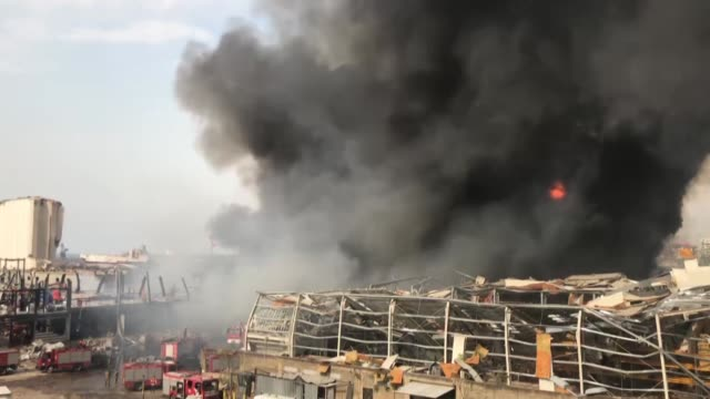 flames reappeared in lebanon's beirut port on thursday, sep. 10, after a large fire broke out in one of its warehouses. in a tweet, the lebanese army... - bombing stock videos & royalty-free footage