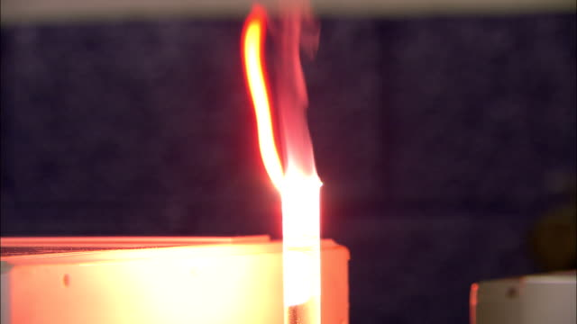 flames rise from a vial of flammable liquid. - flammable stock videos & royalty-free footage