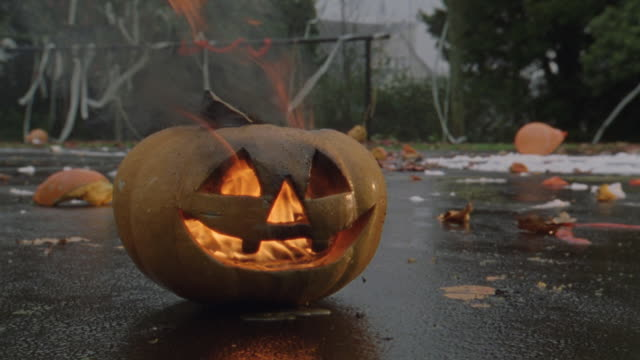 flames rising from a jack o lantern. - jack o' lantern stock videos and b-roll footage