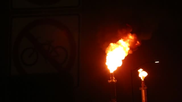 flames shoot from towers at the exxon mobil corp torrance refinery in torrance california us on wednesday march 16 2016 city officials said the... - torrance stock videos & royalty-free footage