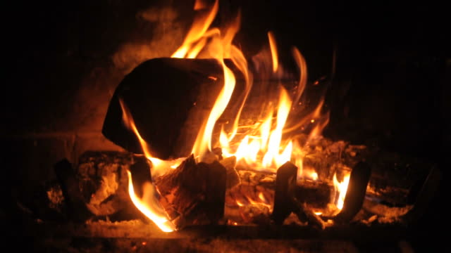 flaming logs in fireplace closeup- loopable - metal clip stock videos and b-roll footage