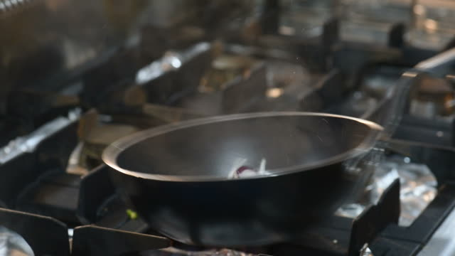 hd flaming onions in skillet - onion stock videos & royalty-free footage