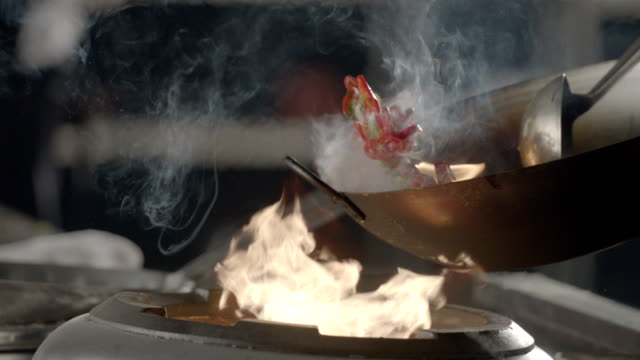Flaming stir fry, slow motion