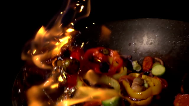 flaming stir fry, slow motion - high speed photography stock videos & royalty-free footage