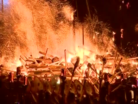 flaming torches are being thrown onto a replica viking galley as part of the up helly aa festival - galeere stock-videos und b-roll-filmmaterial