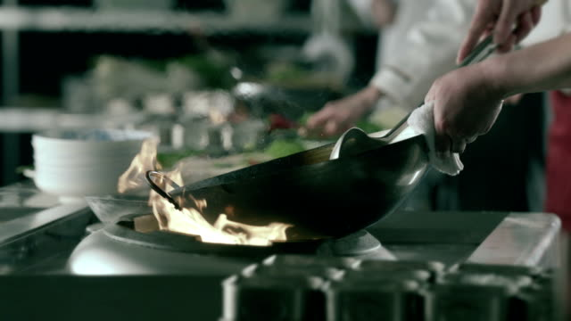 HD Flaming Vegetables in skillet,slow motion