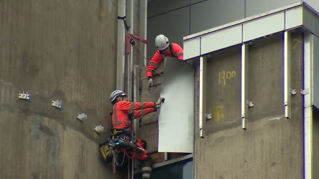 flammable cladding on high rise apartment block being removed - flammable stock videos & royalty-free footage