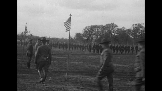 flanked by american flags gen john pershing watches as soldiers march before him / he chats with other officers shakes hands and leaves by automobile... - john pershing stock videos & royalty-free footage