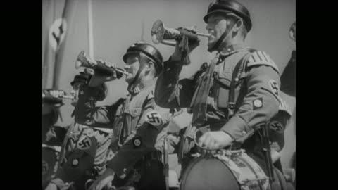 flanked by heinrich himmler and viktor lutze, adolf hitler walks to the front of the 1937 nuremberg rally - 1937 bildbanksvideor och videomaterial från bakom kulisserna