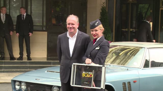 vídeos y material grabado en eventos de stock de flanked by vintage sports cars and glamorous flight attendants author william boyd on wednesday unveiled the new james bond novel solo in which he... - william boyd