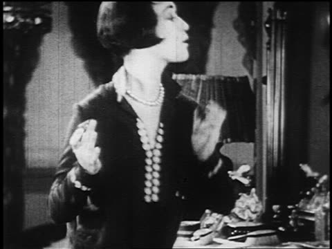 b/w 1925 profile flapper putting on lipstick + admiring herself in mirror - 1920 stock videos & royalty-free footage