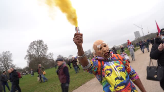 "flare is let off on march 20, 2021 in london, england. ""world wide rally for freedom"" protests, with apparent links to the qanon conspiracy-theory... - city life stock videos & royalty-free footage"