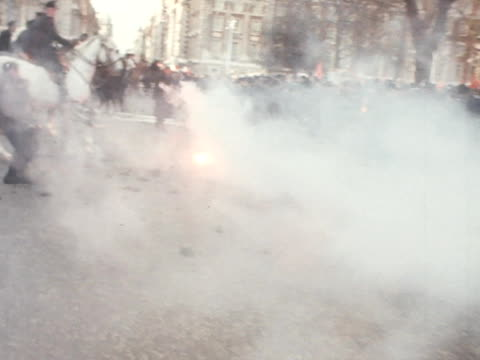 flares are thrown at police officers during an anti vietnam war demonstration outside the american embassy at grosvenor square - 1968 stock videos & royalty-free footage