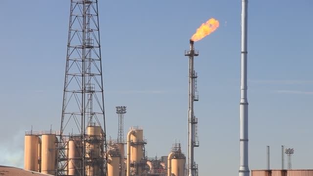 flaring off waste gas at ravenscraig steel works on teeside uk - metal industry stock videos & royalty-free footage