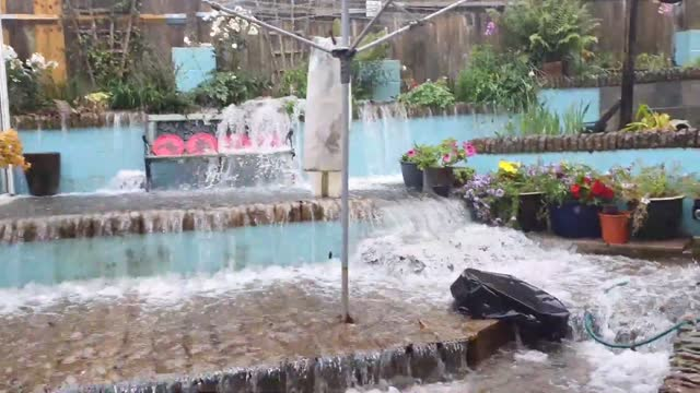 stockvideo's en b-roll-footage met flash flooding in the city of plymouth, on england's south coast,... - https