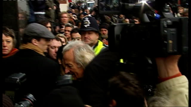 flash photography* photographers crowding round van containing assange as it arrives at westminster magistrates' court various views of john pilger ,... - john pilger stock videos & royalty-free footage