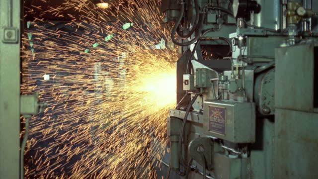 1969 MONTAGE Flash welding steel rails for British Railways in the mill / United Kingdom