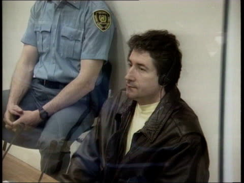 stockvideo's en b-roll-footage met collection t26049501 2641995 former yugoslavia war crimes trial of dusan tadic the hague pool dusan tadic stands behind bullet proof screen in... - 1995