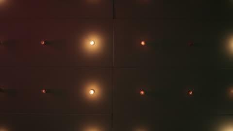 flashing lights on the ceiling at the movies shot from underneath - biosalong bildbanksvideor och videomaterial från bakom kulisserna